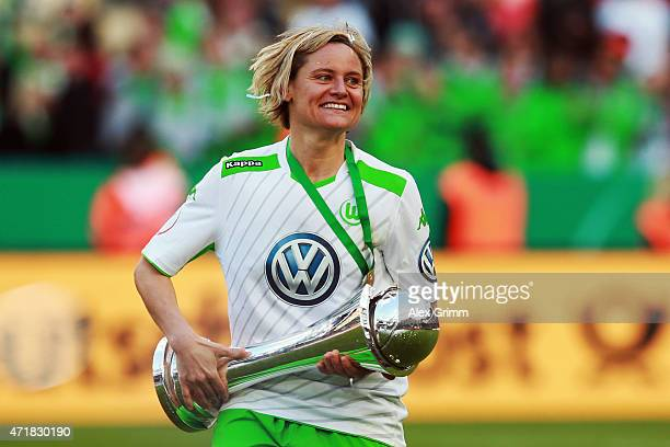 Martina Mueller of Wolfsburg celebrates with the trophy after winning the Women's DFB Cup Final between Turbine Potsdam and VfL Wolfsburg at...