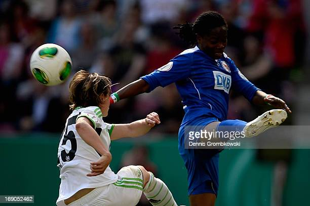 Martina Mueller of Wolfsburg clears the ball under the pressure of Genoveva Anonma of Potsdam during the Women's DFB Cup Final between VfL Wolfsburg...