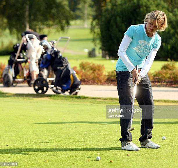 Martina Mueller plays a put during a German National Team golf session at Tammer Golfclub on August 29 2009 in Tampere Finland