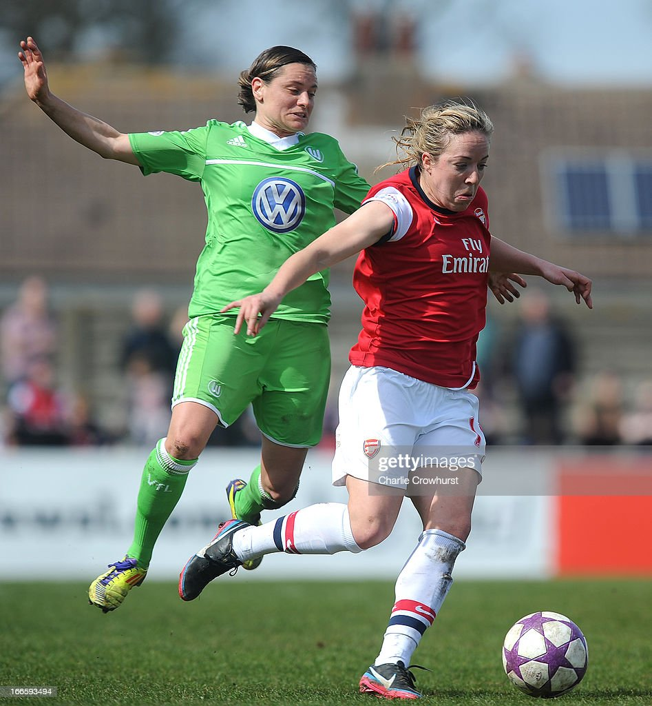 Martina Muller (L) of Wolfsburgin action with Gemma Davison of Arsenal during the UEFA Women's Champions League Semi Final First Leg match between Arsenal Ladies and VFL Wolfsburg at Meadow Park on April 14, 2013 in Borehamwood, England.