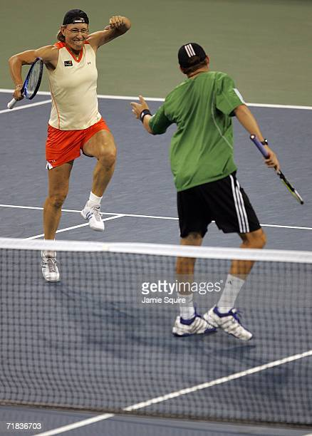 Martina Navratilova and Bob Bryan celebrate a point during the mixed doubles final against Kveta Peschke and Martin Damm of the Czech Republic during...