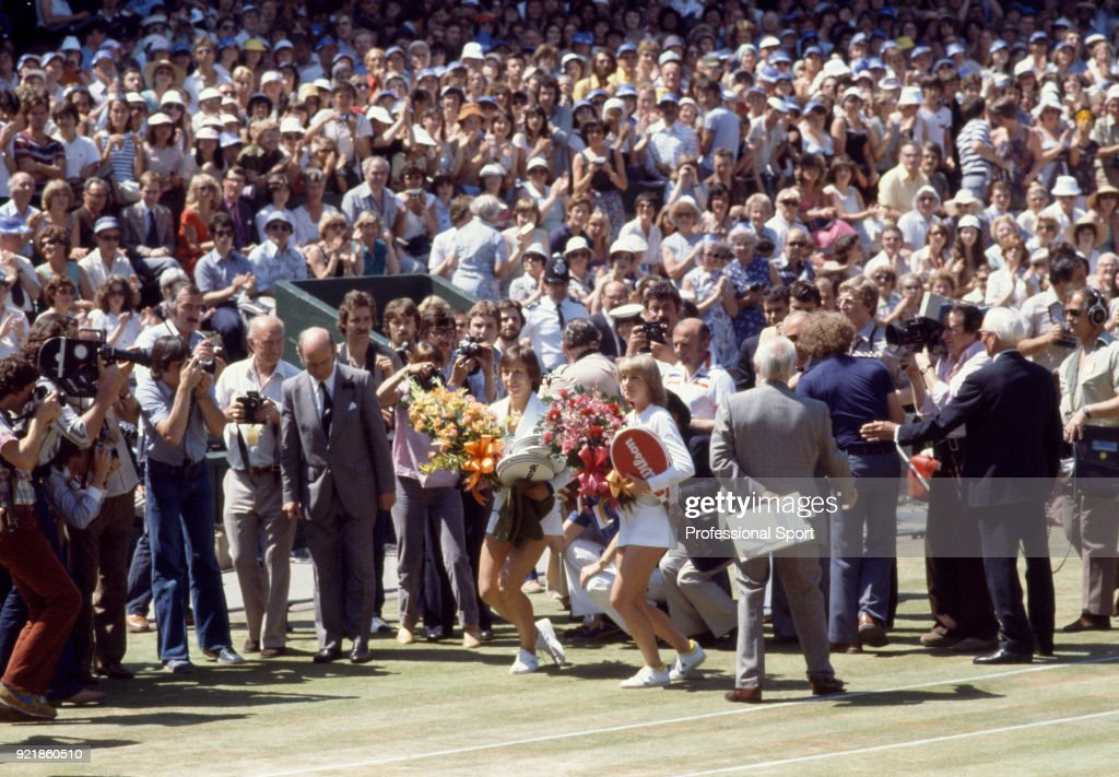 Martina Navratilova (left) and Chris Evert-Lloyd both of the USA (holding flowers) curtseying to the Royal Box on Centre Court ahead of the Women's Singles Final of the Wimbledon Lawn Tennis Championships at the All England Lawn Tennis and Croquet Club, on July 6, 1979 in London, England.