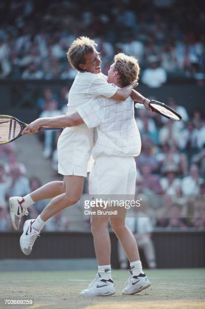 Martina Navratilova and Jonathan Stark of the United States celebrate winning the Mixed Doubles Final match against Gigi Fernandez and Cyril Suk...