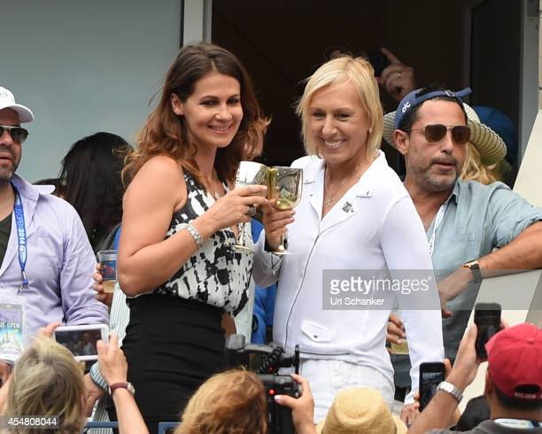 Martina Navratilova and Julia Lemigova celebrate their engagement during day 13 of the 2014 US Open at USTA Billie Jean King National Tennis Center...