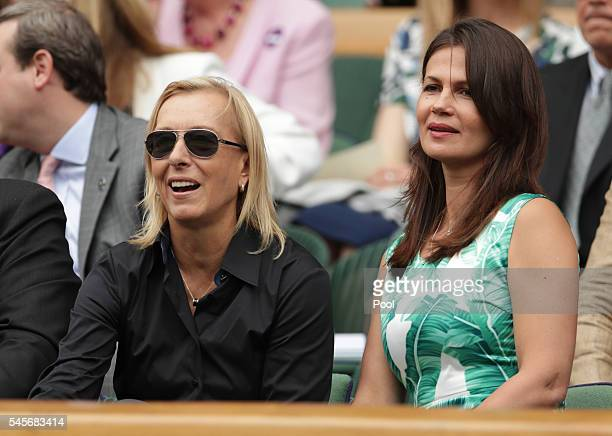 Martina Navratilova and Julia Lemigova watch on as Serena Williams of The United States and Angelique Kerber of Germany play in the Ladies Singles...