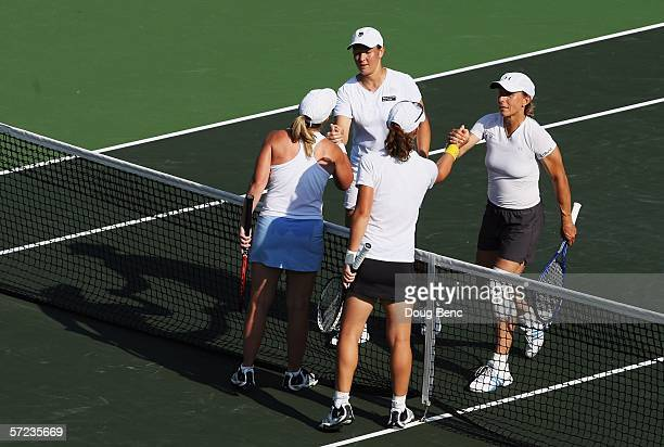 Martina Navratilova and Leisel Huber of South Africa congratulate Samantha Stosur of Australia and Lisa Raymond for winning the women's doubles final...