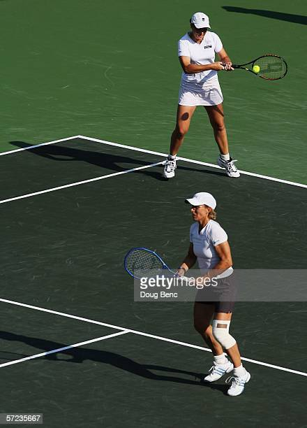 Martina Navratilova and Leisel Huber of South Africa returns a shot to Samantha Stosur of Australia and Lisa Raymond during the women's doubles final...