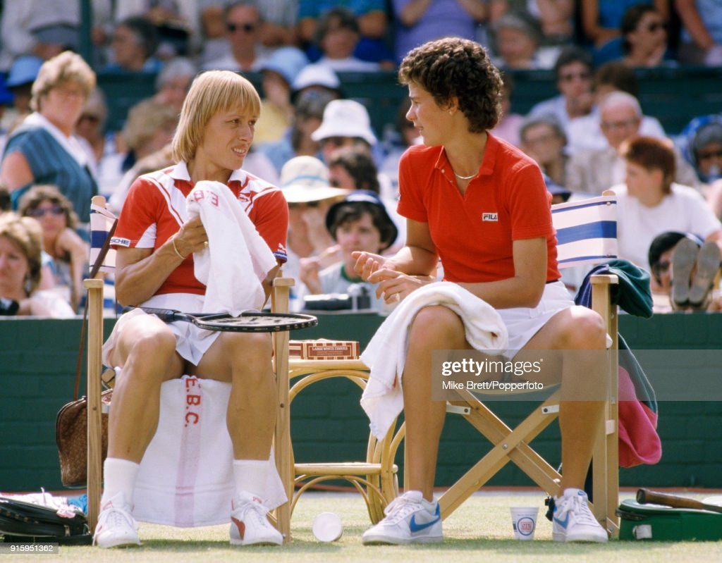 Martina Navratilova (left) and Pam Shriver of the USA enroute to winning the women's doubles competition from Jo Durie of Great Britain and Ann Kiyomura of the USA in straight sets at Eastbourne, circa June 1984.