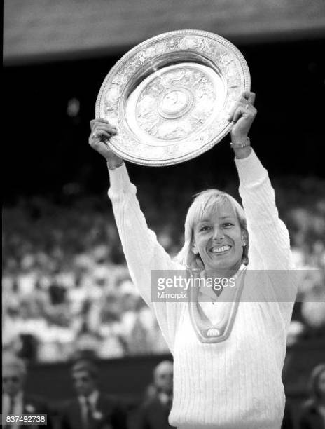 Martina Navratilova beat Chris Evert and won the Wimbledon ladies singles final and hold up the trophy