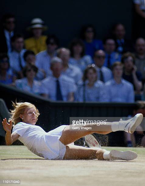 Martina Navratilova falls to the ground during her Women's Singles Final match against Steffi Graf at the Wimbledon Lawn Tennis Championships on 4th...