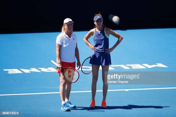 Martina Navratilova of the United States and Daniela Hantuchova of Slovakia talk tactics in their women's doubles match against Alicia Molik of...