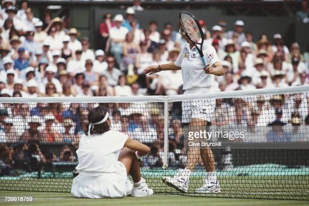 Martina Navratilova of the United States gives a friendly tap across the net with her racquet to Gigi Fernandez during their Semi Final match at...
