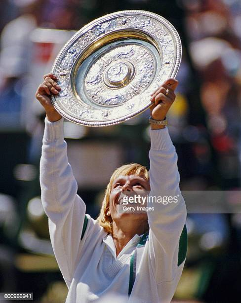 Martina Navratilova of the United States holds the Rosewater Plate aloft after winning the Women's Singles Final match against Steffi Graf at the...
