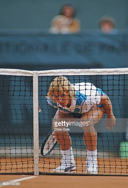 Martina Navratilova of the United States looks through the net during her Women's Singles Final match agaionst Steffi Graf at the French Open Tennis...