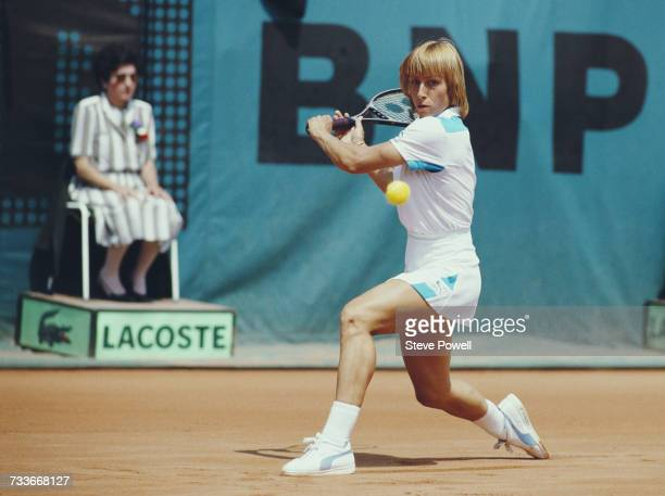 Martina Navratilova of the United States makes a backhand return against Chris Evert during their Women's Singles Final match at the French Open...
