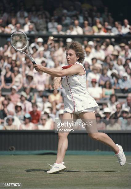 Martina Navratilova of the United States makes a forehand return to Chris Evert during their Women's Singles Semi Final match at the Wimbledon Lawn...
