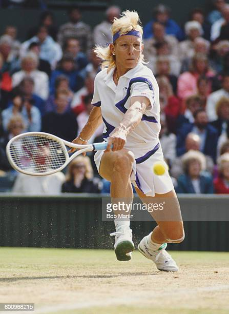Martina Navratilova of the United States stretches to make a back hand return during the Women's Singles Final match against Zina Garrison at the...