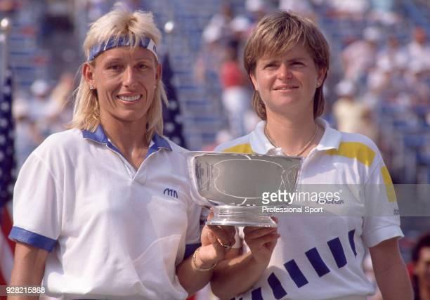 Martina Navratilova of the USA and Hana Mandlikova of Australia pose with the trophy after defeating Mary Joe Fernandez and Pam Shriver both of the...