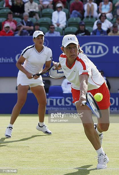Martina Navratilova of the USA and Liezel Huber of South Africa in action during their doubles semifinal against Lisa Raymond and Samantha Stosur of...