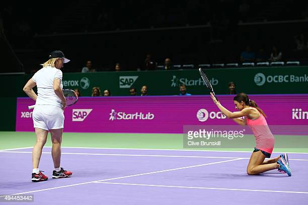 Martina Navratilova of the USA and Marion Bartoli of France in action against Tracy Austin of the USA and Arantxa Sanchez-Vicario of Spain in a...