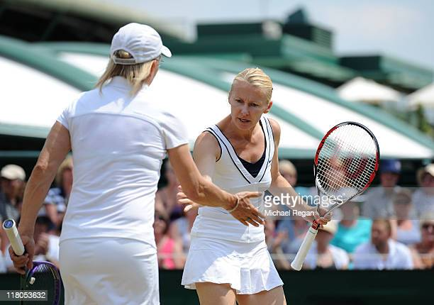 Martina Navratilova of the USA celebrates with partner Jana Novotna of the Czech Republic during the Ladies' Invitation double match against Martina...