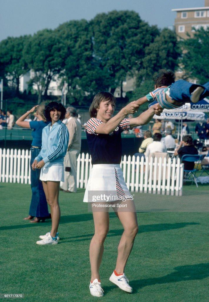 Martina Navratilova of the USA entertains a toddler during the Colgate International tennis tournament at Devonshire Park circa June, 1979 in Eastbourne, England.