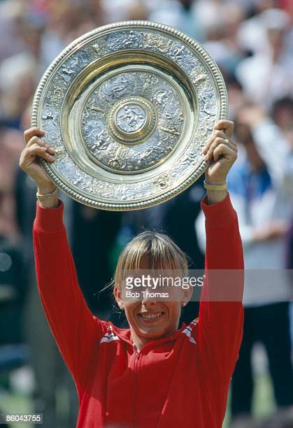 Martina Navratilova of the USA holds the trophy after winning the Ladies Singles Final at the Wimbledon Lawn Tennis Championships held in London...