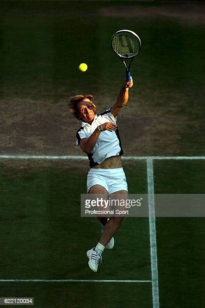 Martina Navratilova of the USA in action with her partner Leander Paes of India against Andy Ram of of Israel and Anastassia Rodionova of Russia in...