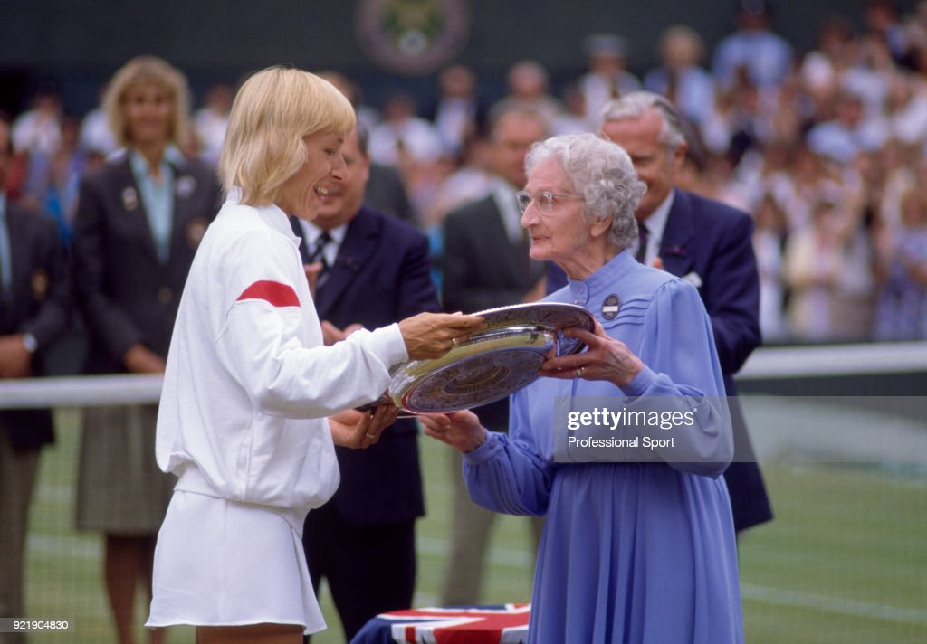 Martina Navratilova of the USA (left) is presented with the trophy by tennis legend and former Wimbledon champion Kitty Godfree after defeating Hana Mandlikova of Czechoslovakia (not in picture) in the Women's singles Final of the Wimbledon Lawn Tennis Championships at the All England Lawn Tennis and Croquet Club on July 5, 1986 in London, England.