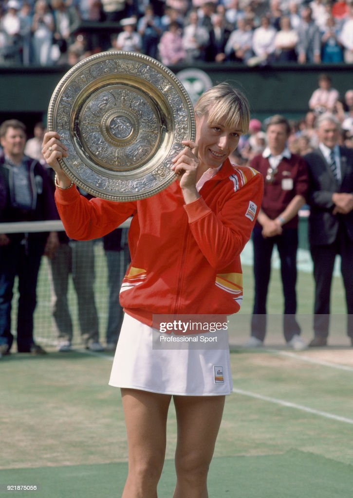 Martina Navratilova of the USA lifts the trophy after defeating Chris Evert of the USA (not in picture) in the Women's Singles Final of the Wimbledon Lawn Tennis Championships at the All England Lawn Tennis and Croquet Club on July 3, 1982 in London, England.