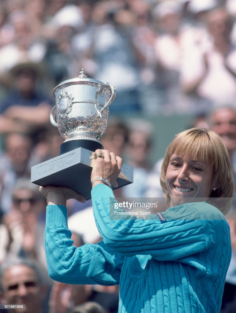 Martina Navratilova of the USA lifts the trophy after defeating Chris Evert-Lloyd of the USA (not in picture) in the Women's Singles Final of the French Open Tennis Championships at the Stade Roland Garros on June 9, 1984 in Paris, France.