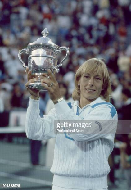 Martina Navratilova of the USA lifts the trophy after defeating Chris EvertLloyd of the USA in the Women's Singles Final in the US Open at the USTA...