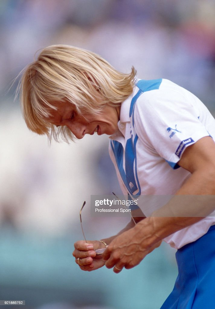 Martina Navratilova of the USA looking at her glasses during the French Open Tennis Championships at the Stade Roland Garros circa May, 1986 in Paris, France.