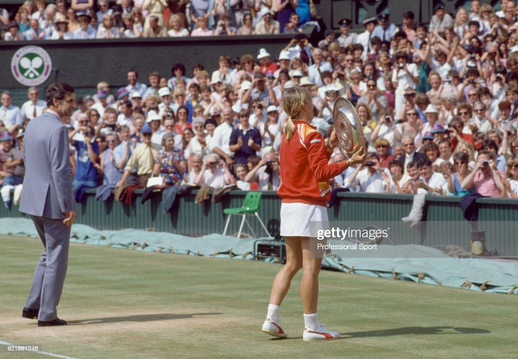Martina Navratilova of the USA poses with the trophy after defeating Andrea Jaeger of the USA (not in picture) in the Women's Singles Final of the Wimbledon Lawn Tennis Championships at the All England Lawn Tennis and Croquet Club on July 2, 1983 in London, England. On the left is Chris Gorringe, the Chief Executive of the All England Club.