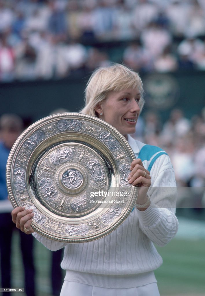 Martina Navratilova of the USA poses with the trophy after defeating Chris Evert-Lloyd of the USA (not in picture) in the Women's Singles Final of the Wimbledon Lawn Tennis Championships at the All England Lawn Tennis and Croquet Club on July 6, 1985 in London, England.