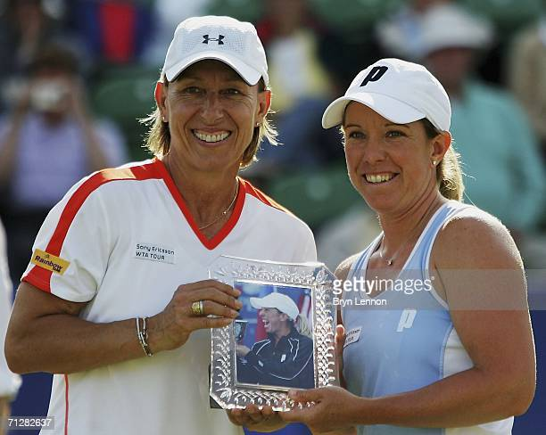 Martina Navratilova of the USA presents Lisa Raymond of the USA with an award marking her achievement of becoming the 13th person to win all 4 Grand...