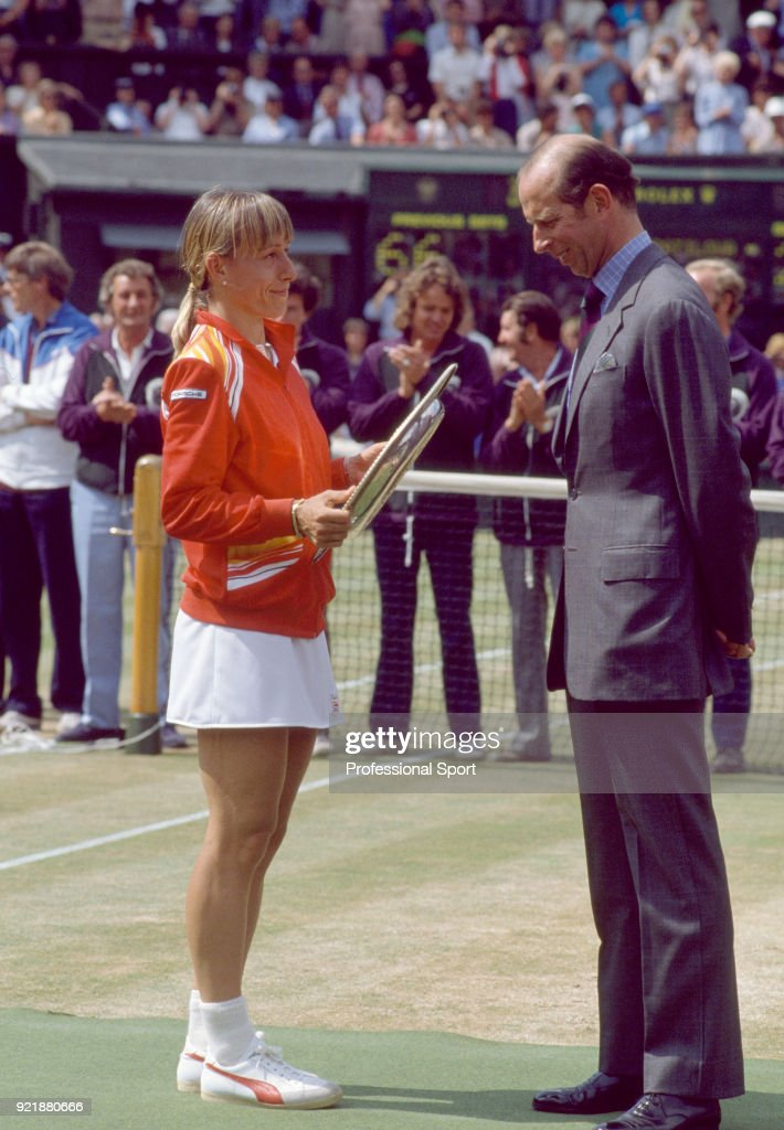 Martina Navratilova of the USA (left) receives the trophy from the Duke of Kent after defeating Andrea Jaeger of the USA (not in picture) in the Women's Singles Final of the Wimbledon Lawn Tennis Championships at the All England Lawn Tennis and Croquet Club on July 2, 1983 in London, England.