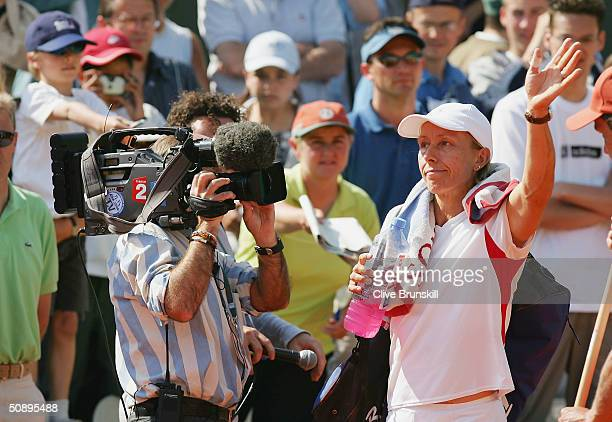 Martina Navratilova of the USA salutes the fans before her first round match against Gisela Dulko of Argentina during Day Two of the 2004 French Open...