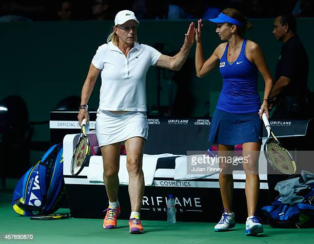 Martina Navratilova of USA and Iva Majoli of Croatia in their legends match against Marion Bartoli of France and Tracy Austin of USA during day three...