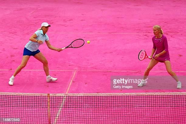 Martina Navratilova of USA and Jana Novotna of Czech Republic play on a pink clay court in the women's legends doubles semi final match against...