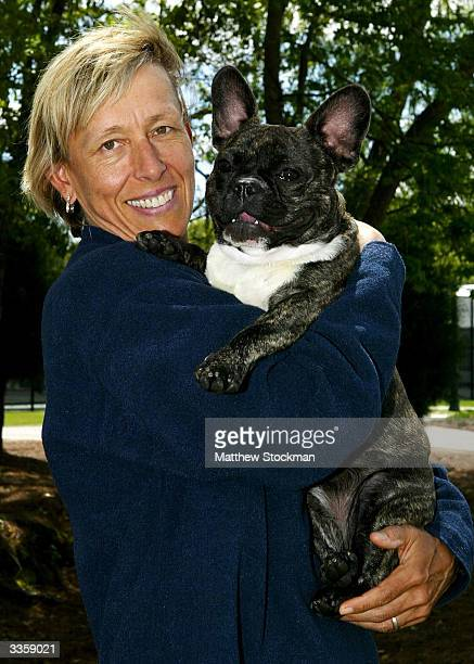 Martina Navratilova poses with one of her many dogs during the Family Circle Cup April 14 at the Family Circle Cup Tennis Center in Charleston South...