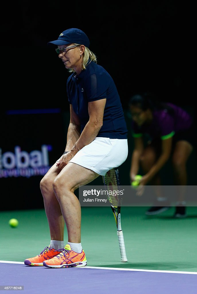 Martina Navratilova with (out of frame) Tracy Austin of USA in their legends match against Marion Bartoli of France and Iva Majoli of Croatia during day four of the BNP Paribas WTA Finals tennis at the Singapore Sports Hub on October 23, 2014 in Singapore.