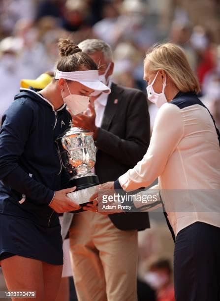 Martina Navratilovapresents Match Winner Barbora Krejcikova of Czech Republic with her winners Trophy after the Women's final on day fourteen of the...