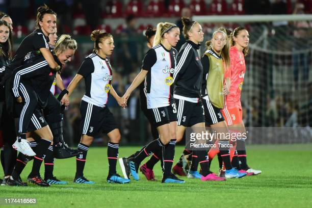 Martina Rosucci and Barbara Bonasea of FC Juventus and her teammates greet the fans at the end of the game of the Women's Champions League round of...