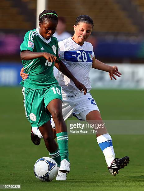 Martina Rosucci of Italy and Esther Sunday of Nigeria battle for the ball during the FIFA U-20 Women's World Cup 2012 group B match between Italy and...