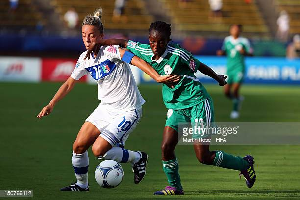 Martina Rosucci of Italy and Fasilat Adeyemo of Nigeria battle for the ball during the FIFA U-20 Women's World Cup 2012 group B match between Italy...