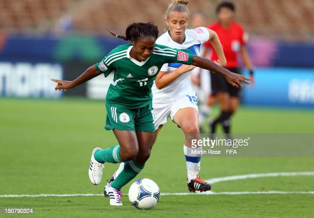 Martina Rosucci of Italy and Francisca Ordega of Nigeria battle for the ball during the FIFA U-20 Women's World Cup 2012 group B match between Italy...