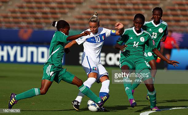 Martina Rosucci of Italy and Gloria Ofoegbu and Asisat Oshoala of Nigeria battle for the ball during the FIFA U-20 Women's World Cup 2012 group B...