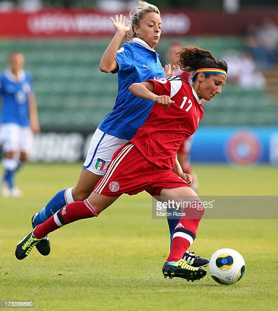 Martina Rosucci of Italy and Nadia Nadim of Denmark battle for the ball during the UEFA Women's Euro 2013 group A match between Italy and Denmark at...