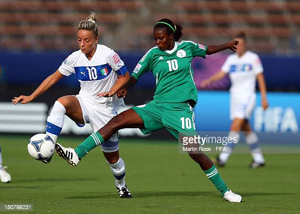 Martina Rosucci of Italy and Ngozi Okobi of Nigeria battle for the ball during the FIFA U-20 Women's World Cup 2012 group B match between Italy and...